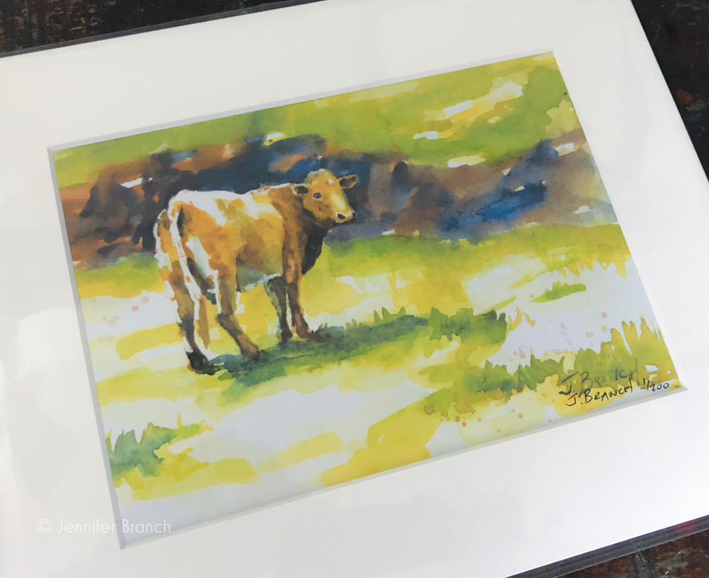 An 8 x 10 print of Cow on the way to its new home.