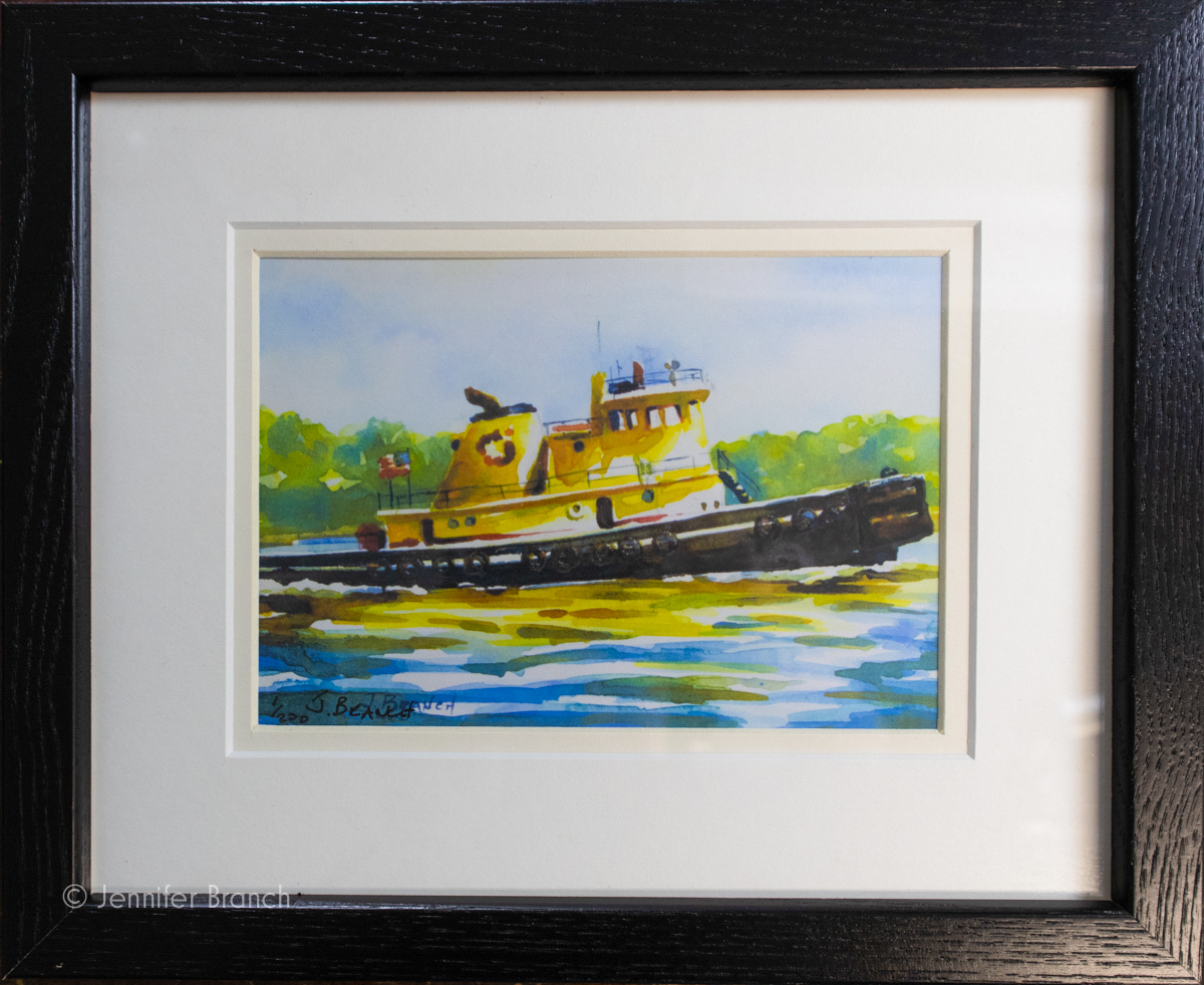 Yellow Tugboat print in black frame.