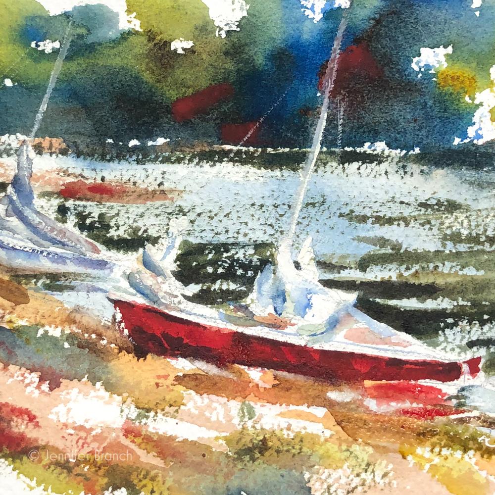 2 sailboats on a beach.